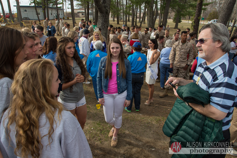 The students mingled outside with the soldiers, guests and other students