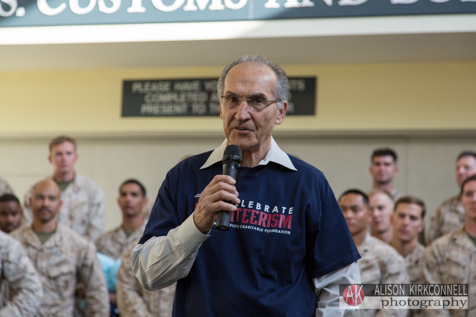 Retired longtime Patriots broadcaster Gino Cappelletti addresses the audience