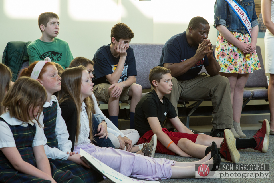 Students watch the ceremony with former Patriots player Jon Williams