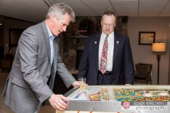 Former US Senator Scott Brown plays pinball at the home of NH state representative Charles McMahon on October 18, 2014